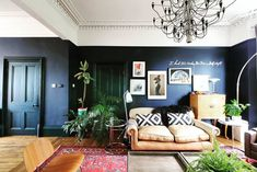 The home of Greg  is a masterclass in how to renovate and turn a former dentist surgery into a super stylish family home. He used Little Greene ' Dock Blue' in his sitting room, which looks fabulous against all the plants and pattern here. Blue And Pink Living Room, Dark Blue Rooms, Dark Blue Walls, Hallway Colours, Dark Interiors, Home Decor Trends, Home Living Room, Bedroom Wall, Family Room