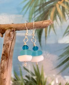 The wonderful colors of the sea come together in these beautiful Sea Glass artisan Jewelry~ Sea Glass Jewelry~ Earrings  I have created this tropical pair using cultured recycled sea glass. Colorful Aqua Blue , Pacific bay and opaque white and cultured beach glass . Light & comfortable these earrings measure approximately 1 1/2 inches and that includes the ear designer wires. OOAK one of a kind artist designed. This will make a wonderful Holiday gift for the beach lover, nature lover...