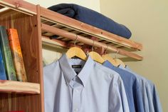 DIY Closet organization system feature one solid cedar cubby kit with ventilated shelves and two ventilated hanging kits, four hanging rods total.