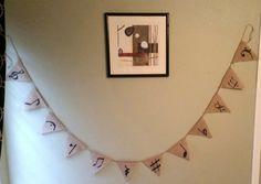 Hanging burlap banner  https://www.etsy.com/listing/239092421/hanging-burlap-banner-with-music-symbols