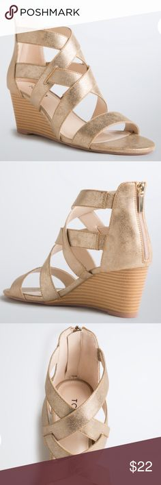 """Torrid Gold Strappy Mini Sandal Wedges size 8W Up for grabs is this pair of sandals from Torrid. They are a size 8W and have a 2.5"""" mini wedge heel. These shoes are a strappy sandal style with a wedge heel. The straps are gold colored faux leather with a zip back. The gold straps criss cross over the foot. These wedges are new with the original tag sticker. *These shoes were sold in stores without a box, so no box is included.* torrid Shoes Sandals"""