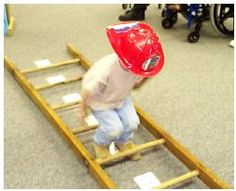 Fire Ladder Jump with Numbers:  We taped the numbers 1-10 between the rungs of a large wooden ladder.  The children then took turns counting and jumping through the rungs of the ladder.  We held hands on either side of the jumping child and gave a boost as necessary so that everyone would be successful regardless of jumping ability.