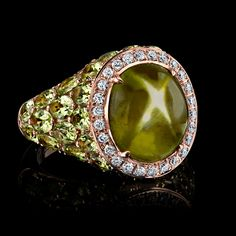 A Rare and Unique Star Peridot surrounded by Pave White Diamonds and over 9 cts of Green Peridots: Robert Procop Exceptional Jewels