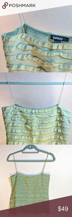 DKNY Spaghetti Strap Ruffle Top | NWOT Love love love this DKNY classic wardrobe staple!  .  Wear it resort-side to make a splash, or rock it under a suits for a pop of color so year round.  Spaghetti straps, mint or sage green tank.  .  Very expensive high quality material will last you a long, long time.  Not worn! DKNY Tops Tank Tops
