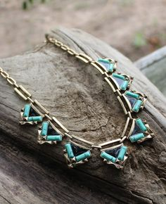 """Black and green enamel triangles in a gold tone setting. Take your outfit from basic to bold with a bright colored statement necklace. Length: 17.5"""" + 3.5"""" ext"""