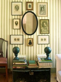 Striped wallpaper with a cluster of portraits and silhouettes. #decor #sittingrooms #stripes