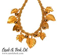 Napier, signed, gold plated textured link chain with  leaves and berries dangles.17 inches long.$195.