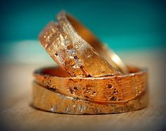 Beautiful rustic design of unique wedding bands, combination of white and red gold 14ct with diamonds.