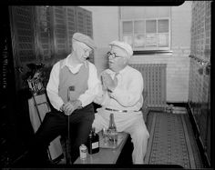 Drinking whiskey in the locker room at the Woodland Golf Club by Boston Public Library