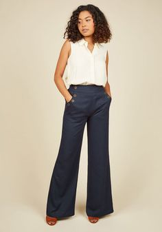 You take any opportunity to go above and beyond so today, you apply your next-level attitude to your style by wearing these wide-legged navy trousers. The bronze sailorette buttons lining the pockets are your medallions of honor for forward-thinking!