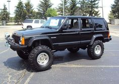 '96 Jeep Cherokee ... apparently once owned by Parnelli Jone. Always thought these 90s Cjerokee looked good lifted.