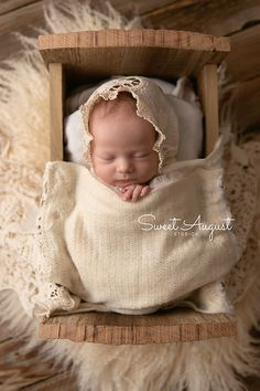 Denver newborn photographer - Sweet August Studios.  Baby girl in tiny bed, neutral newborn
