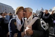 A couple dances the tango in front of St. Peter's Square to celebrate Pope Francis' 78th birthday, Wednesday, Dec. 17, 2014.
