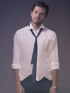 The shirts untucked and it just screams for someone to take it off the rest of the way...I volunteer!