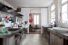Parisian apartment of Paola Navone ;) Vosgesparis.blogspot.com - notice the floor-to-ceiling drapes between the kitchen and dining rooms; nice.