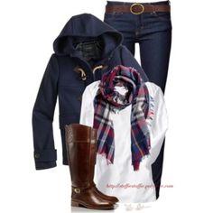 Jean foncé, blouson bleu marine, bottes marrons et grosse écharpe écossaise.