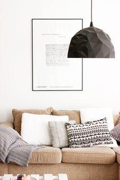 The neutral cushy styling of Taru's sofa via Sort Of Pink