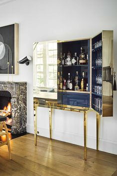 We're spotlighting 38 chic home bar ideas to inspire you. Whether you want to build out a home bar, or just want to turn part of your kitchen counter into one, we've got ideas to help you make it happen below. Interior Design Tips, Interior Styling, Home Bar Cabinet, Smart Tiles, Home Bar Designs, Bars For Home, Bar Ideas, Decor Ideas, Home Goods