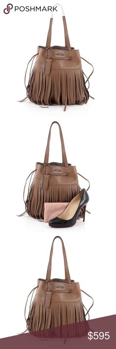 """Miu Miu Fringe Shoulder Bag Leather Medium Condition: Great. Slight creasing on exterior, wear on base corners, minor splitting on opening wax edges near handle base. Minimal wear in inteiror and fringe.  Accessories: Leather clochette and dust bag.  Measurements: Handle Drop 9"""", Height 12"""", Width 11"""", Depth 3.5"""" Designer: Miu Miu Model: Fringe Shoulder Bag Leather Medium Item Number: 23255/04 Miu Miu Bags Shoulder Bags"""