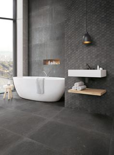 For a bathroom with a seamless and contemporary feel, consider opting for minimalist grey tiles on both the floor and the walls. Pair with crisp white and warm wood accessories for a luxe bathroom. Best Bathroom Flooring, Bathroom Floor Tiles, Bathroom Layout, Bathroom Interior Design, Bathroom Ideas, Bathroom Designs, Bathroom Feature Wall Tile, Bathroom Taps, Bathroom Organization
