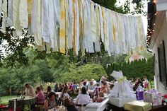 Non-traditional banner - tear strips of old sheets and tie them to a rope to hang across as a shabby-chic banner!