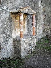 """Lararium"" (=Altar for household gods) at Pompeii"