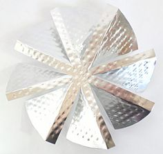 Windmill made from an aluminum pie pan.