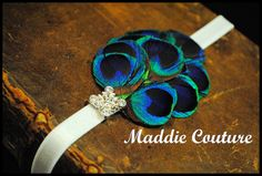 Vintage Baby Girl Peacock Feather headband by MaddieCoutureStyling. $12.99 USD, via Etsy.