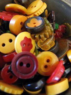Diminutive Bakelite buttons by lorimarsha, via Flickr