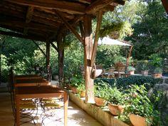 """terrasse des petits déjeuners et diners aux chambres d'hôtes du Moulin. Breakfast and dinner's place from guest house """"moulin de rocquebert""""."""