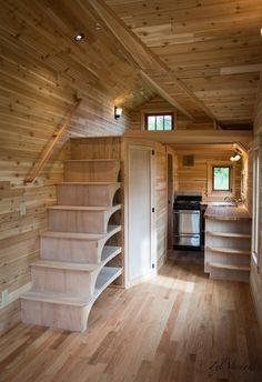 Inside the tiny house is an all natural wood finish with oak flooring and a skylight over the living room. wood Fuchsia by Zyl Vardos - Tiny Living Tiny House Layout, Tiny House Cabin, Tiny House Living, Tiny House Plans, Tiny House Design, Tiny House On Wheels, House Layouts, Tiny Houses, Dog Houses