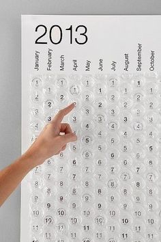 2013 bubble wrap wall calendar. Who doesn't love popping bubble wrap. Would make a good deployment countdown too!