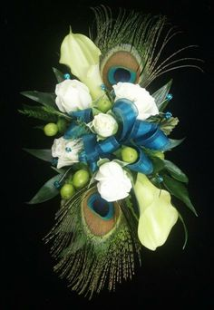 Peacock Feather Wrist Corsage - cala lilies, hypericum berries, sweetheart roses with a teal ribbon.  Created by Jane's Flower Shoppe, New Holland, PA