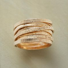 """BYWAYS RING -- Signifying life's twists and turns, a textured ribbon of glowing 14kt gold filled is forever fused in a circuitous route around the finger. A handcrafted exclusive. Whole sizes 5 to 9. 1/2""""W."""