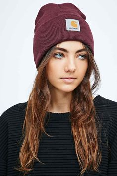 The maroon beanie matches perfectly with her bright eyes and light brunette hair