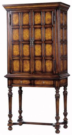 This mahogany and ash burl veneer wine cabinet features a lighted interior with a metal rack to accommodate 12 wine bottles, a glass rack, and a mirrored back wall.    Complete with two drawers for storage.