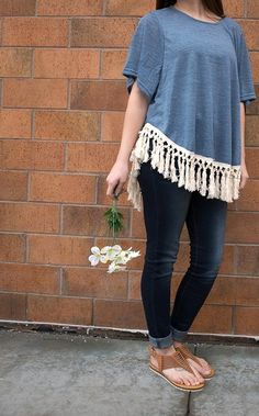 Fringe is our FAVE!  Add a little boho to your closet with this pretty blue top! Top: $39