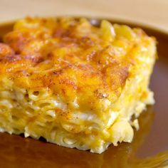 John Legend's Macaroni and Cheese Recipe Side Dishes, Main Dishes with unsalted butter, freshly ground pepper, coarse salt, elbow macaroni, evaporated milk, skim milk, large eggs, seasoning salt, garlic powder, extra sharp cheddar cheese, monterey jack, paprika