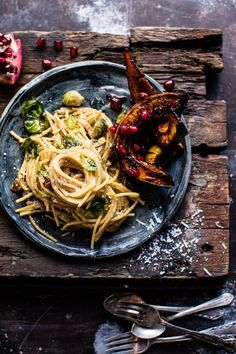 Brussels Sprout Carbonara - sweet & spicy squash + bursts of flavor from the pomegranate arils, make this pasta unlike any other. From http://halfbakedharvest.com