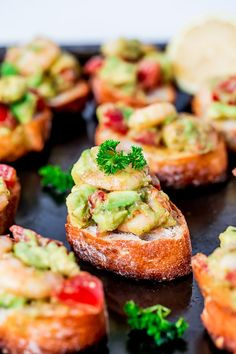 Garlic Prawn and Avocado Crostini on http://cafedelites.com