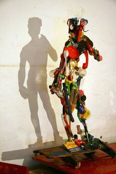 Shadow statue made from garbage. Shadow art is a unique form of sculptural art that creates patterns on a wall or canvas using shadows or silhouettes. It is a cool art activity at home to entertain your family and friends.