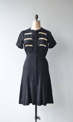 Vintage late 1930s black linen dress with short sleeves, lace abd button bodice detail, button bodice, fitted waist and metal side zipper. --- M E A S U R E M E N T S ---  fits like: small bust: 38 waist: 26 hip: 35.5 length: 40 brand/maker: Cartwright by Martha Gale condition: excellent  to ensure a good fit, please read the sizing guide: http://www.etsy.com/shop/DearGolden/policy  ✩ layaway is available for this item  ✩ more vintage dresses ✩ http://w...