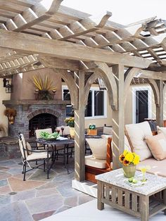 Pergola, love the weathered gray color!!  and the arches.