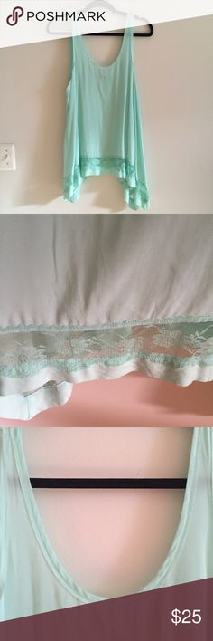 Free People High Low Lace Tank A Free People High Low lace tank in a summery seafoam mint green! EUC; NWOT worn once for a photoshoot and never washed. Lace and trim on neckline is still perfect and not frayed - I have a few of these and they don't wash well so dry clean is a must! Perfect for layering under sweaters for a peek of lace. Offers considered! Red version worn by Elena on The Vampire Diaries. Free People Tops Tank Tops