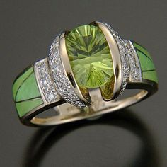 Randy Polk- A 6mm round Peridot with inlay of rare, fresh-green Parrot Wing of Conicalcite from Mexico with 25 pavé diamonds.
