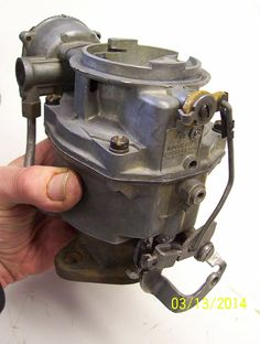 Early 2014: I also rebuilt the 1bbl Rochester carburetor while doing the head job-the yellow nylon/plastic part there is almost impossible to find, and has to do with the choke unloader mechanism, as we used to call it, as I recall anyway.