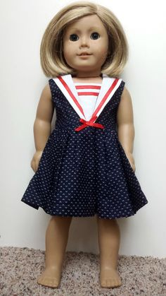 This is a beautiful little dress that reminds me of sailing! It has adorable red ribbon accents and closes in the back with velcro. This item is not