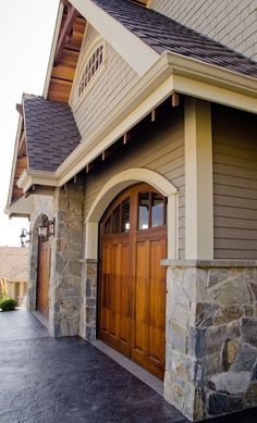 Love stone with linen siding and white trim  Also like the curve above garage door