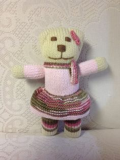 Pink Camouflage Hand-Knitted Girl Teddybear is 11 Inches Tall With An 8 Inch Arm Span, Waiting For A Hug! She Is Filled With Polyester Fiberfill and Is Hand Washable. She Costs $16.00 Plus Shipping. Message Me your Zip Code And An Exact Postal Charge Can Be Given!
