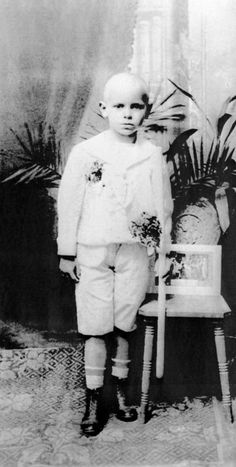 photo taken in the 1930s shows Karol Wojtyla posing with a candle in his hand after receiving First Communion at his home in Cracow.